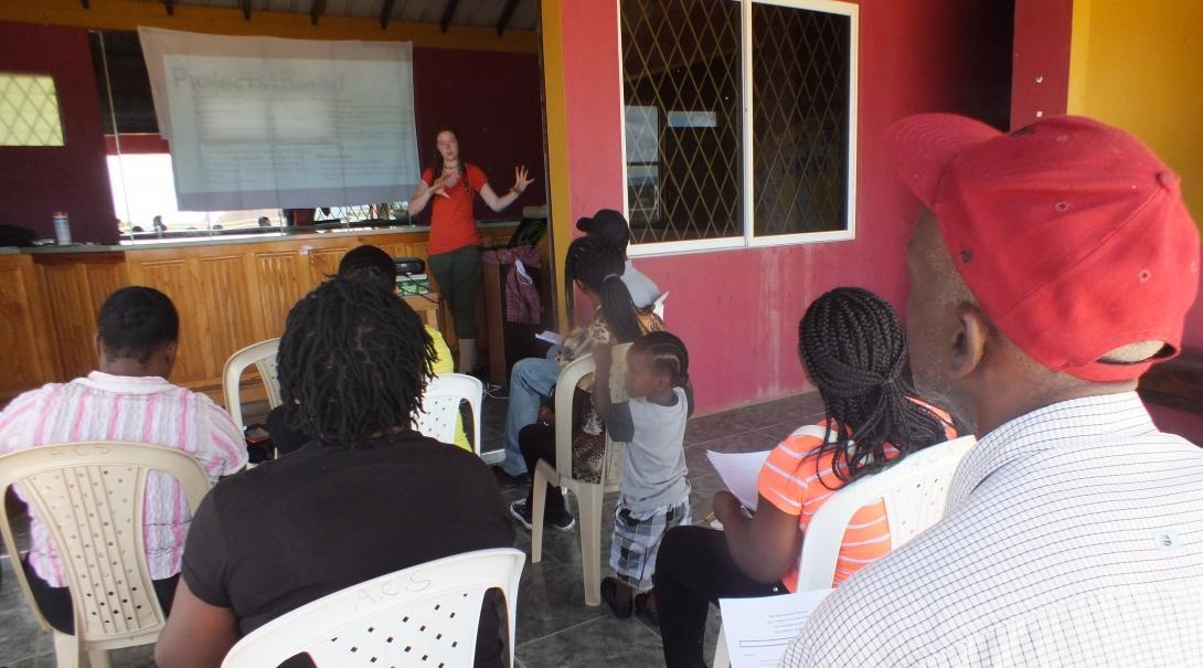International Development Intern teaches a workshop about dealing with natural disasters during Disaster Management Internships in Jamaica.